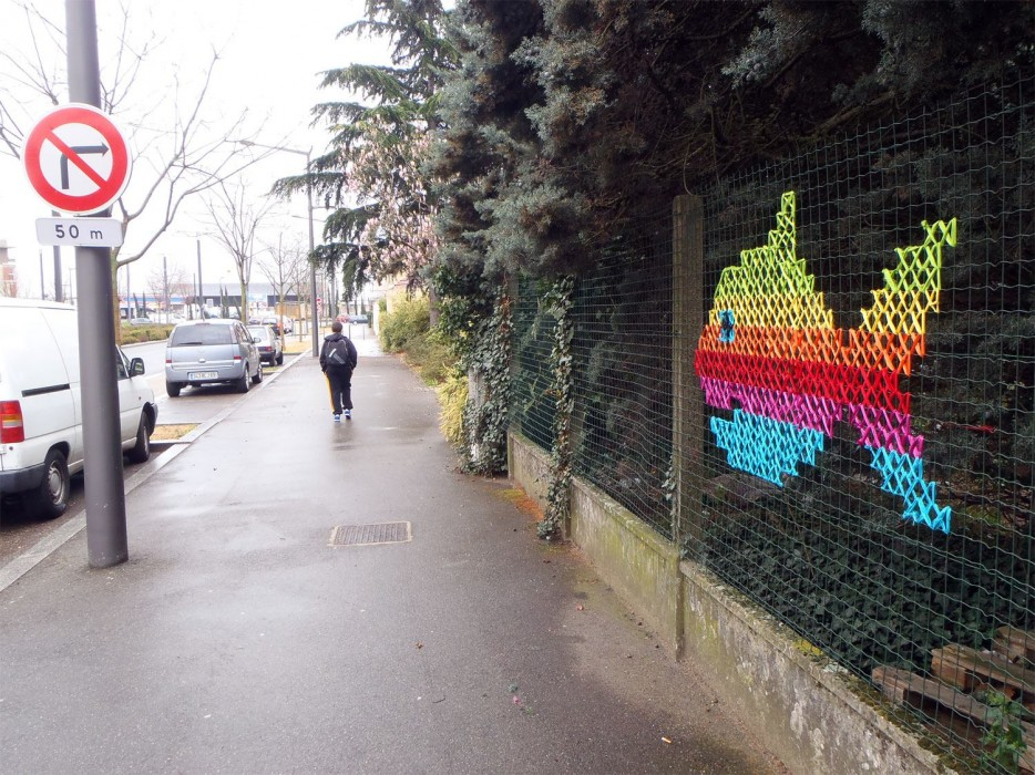 Creative Street Art  CrossStitch Murals on Fences