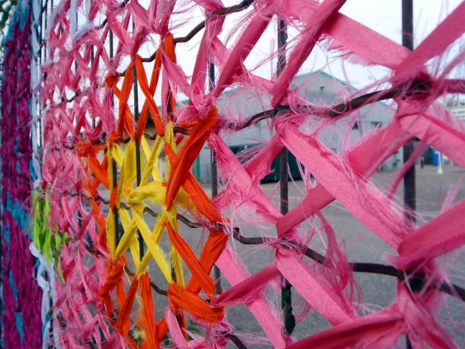 Creative Street Art  CrossStitch Murals on Fences