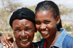 A woman farmer with a young extensionist in Ethiopia