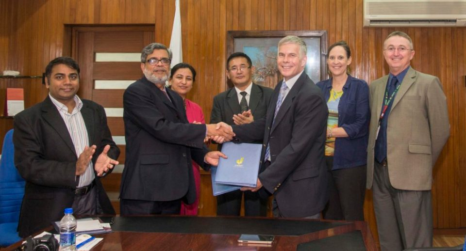 Director SAARC Agriculture Centre Dr SM Bokhtiar and ICRISAT Director General Dr David J. Bergvinson exchanging the signed MoU at ICRISAT headquarters in Hyderabad, India. Also seen are (L –R) Dr Rajeev K Varshney, Research Program Director – Genetic Gains (ICRISAT), Dr Mamta Sharma, Theme Leader – Integrated Crop Management Asia Program (ICRISAT), Dr Tayan Raj Gurung Senior Program Specialist (NRM ) SAARC Agriculture Centre, Ms Joanna Kane Potaka, Director-Strategic Marketing & Communication (ICRISAT) and Dr Peter S Carberry, Deputy Director General Research (ICRISAT). Photo: S Punna, ICRISAT
