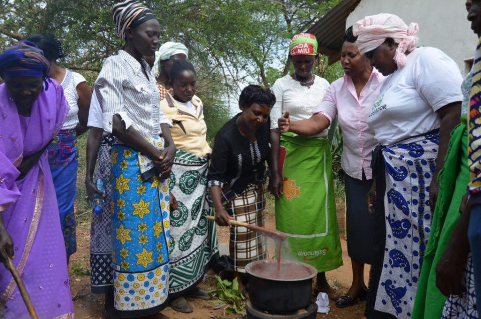 Rural Kenyan women learn a new way to cook finger millet porridge for better nutrition. Photo credit: Alina Paul-Bossuet