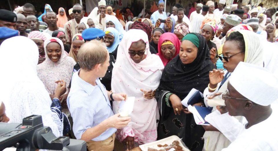 Wife of Katsina state Governor, Hajiya Binta (centre) takes a closer look at the groundnut-based products during the launch. PC: Shafiu Haladu, WOFAN, Nigeria