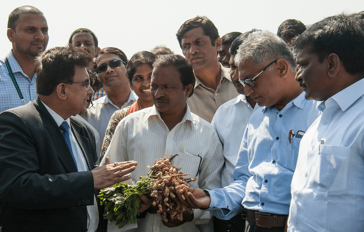Dr SK Malhotra, Agriculture Commissioner, interacting with groundnut farmer Narasimha Reddy on the benefits of oil-rich ICGV 03043.