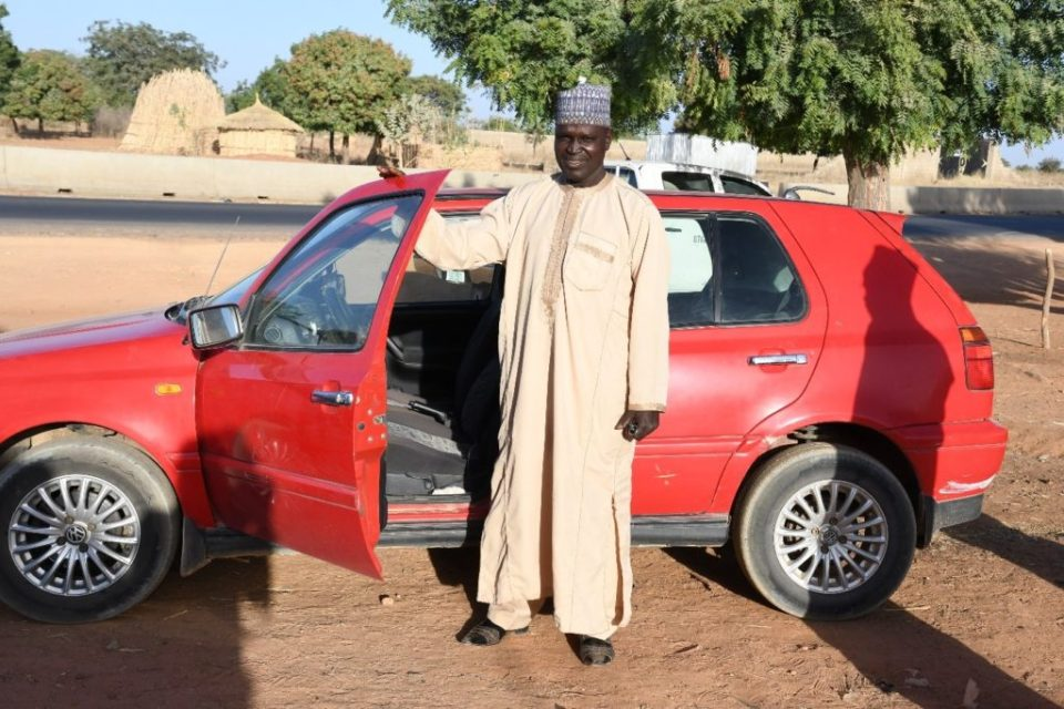 Mr. Sani Ado Oumar was able to buy a new car with the benefits of his product. Photo: A. Diama