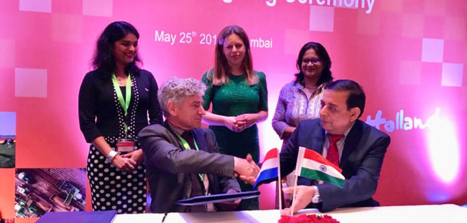 Signing of LOI between ICRISAT and KeyGene- (Sitting Left) Arjen van Tunen, CEO, KeyGene; (Sitting Right) Kiran K Sharma, Deputy Director General Research (Acting ), ICRISAT in the presence of Ms. Carola Schouten ( Standing in Centre), Deputy Prime Minister and Minister of Agriculture, Nature & Food Quality, The Netherlands; Sheetal Dixit (Standing on Left) , Business Development Manager Asia - KeyGene ; Pooja Bhatnagar-Mathur (To the Right) , Theme Leader - Cell, Molecular Biology and Genetic Engineering. Photo: Pooja Bhatnagar-Mathur ICRISAT