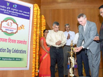 Dr Peter Carberry, Director General (Acting), ICRISAT, lighting the ceremonial lamp as Dr Srinivas Rao, Director, NAARM, looks on (R). Photo: ICAR-NAARM.