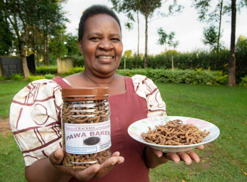 Farmer Pascilisa Wanyonyi of Busia County, Kenya produces finger millet smart foods like these 'crackies'. Supplied: Michael Major/Crop Trust
