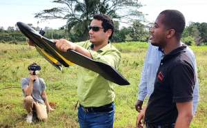 Dr Abhishek Rathore tries his hand at flying a drone at the workshop in Zanzibar, Tanzania. Photo: ICRISAT