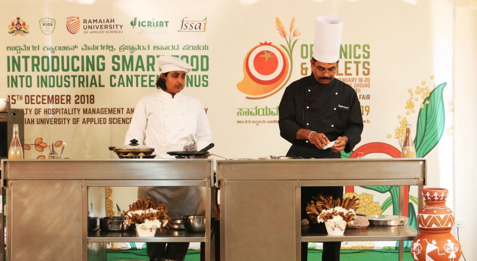 Chefs cook millet-based foods for industrial canteens at the event in Bengaluru. Photo: MS Ramaiah University