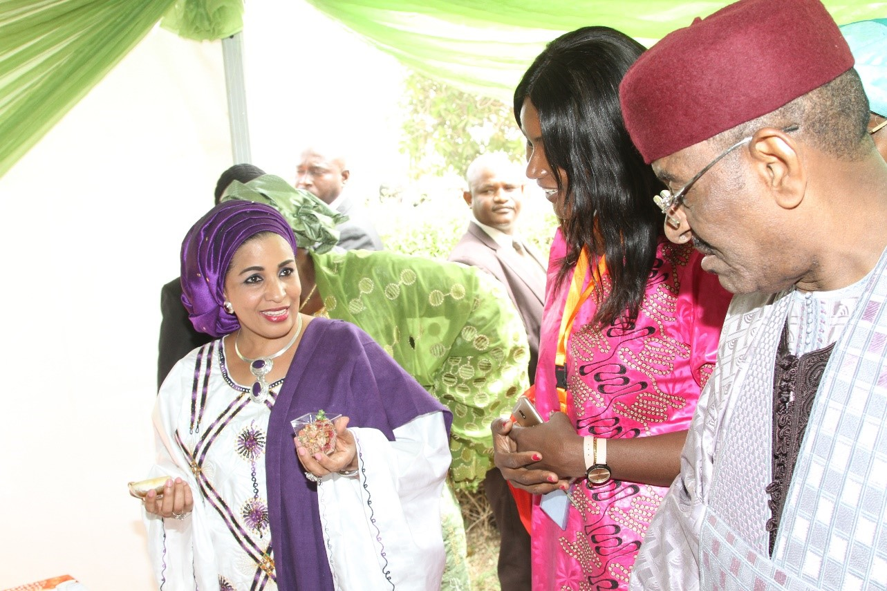 First Lady of Niger (left) and the Minister of Agriculture and Livestock (right) interact with Ms Agathe Diama, Head- Regional Information, WCA-ICRISAT at Smart Food stall.