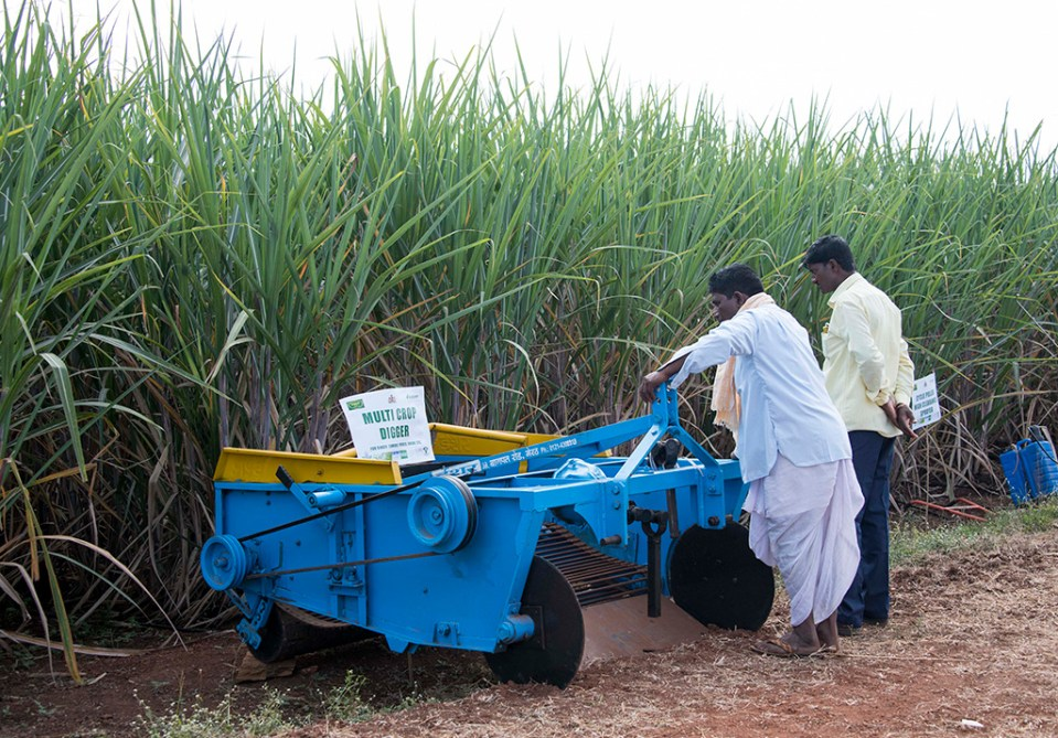 Local farmers observe a multi-crop digger for its features. Photo: S Punna, ICRISAT