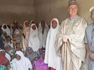 Dr Peter Carberry is presented with traditional dress by local women promoting sorghum products as Smart Food in northern Nigeria. Photo: H Ajeigbe, ICRISAT