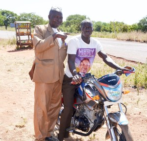 Mr Seydou Dao from Kafona village in Sikasso region, bought a new motorcycle for his younger brother. Photo: S Toure, ICRISAT