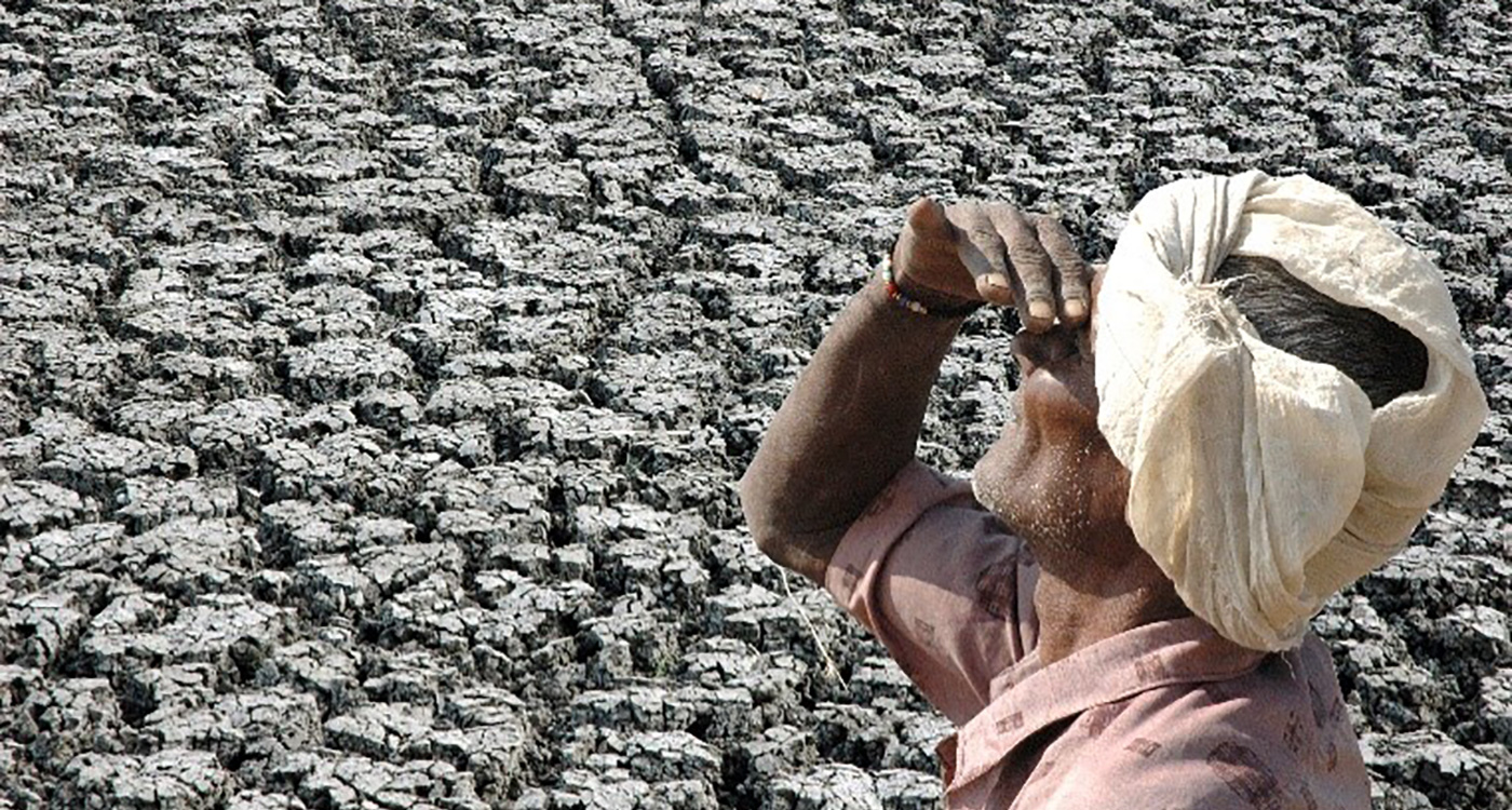 A farmer on his parched land in India. Photo: L Vidyasagar, ICRISAT