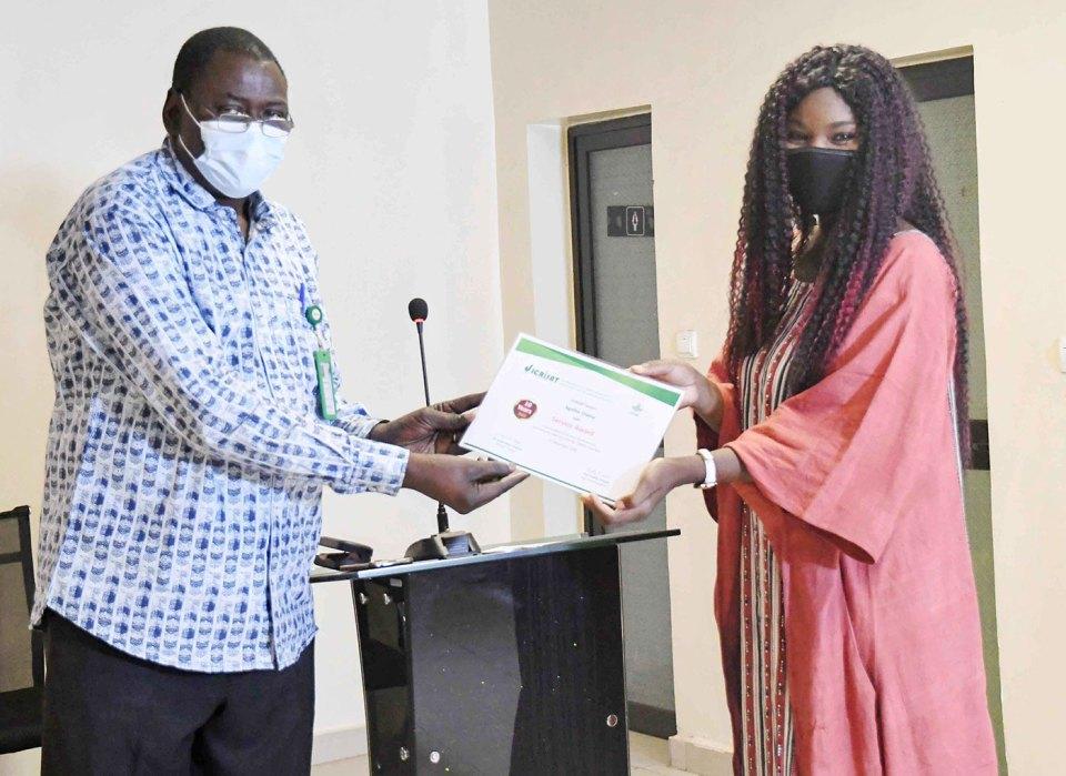 Dr Ramadjita Tabo, Research Program Director, WCA, hands over the 10-year service certificate to Ms Agathe Diama, Regional Head, Communications, WCA, in Bamako, Mali. Photo: ICRISAT, WCA
