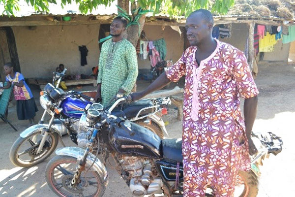 Cooperative members show their motorcycles purchased from incomes gained through sorghum production and commercialization via the warrantage system. Photo: A. Diama, ICRISAT