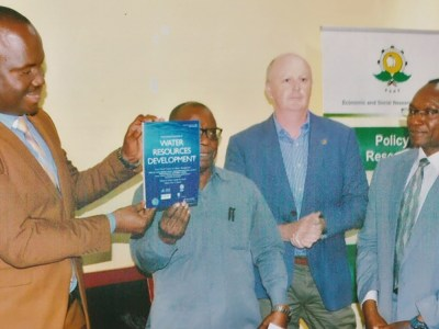 (L to R) Mr Gerald M Kusaya, Permanent Secretary of The Ministry of Agriculture, Tanzania, releasing the special journal issue during a National Policy Dialogue held in Dodoma, December 2020. Also in the photo Mr Abel Songole (ESRF), Dr Anthony Whitbread ICRISAT and Dr Makarius Mdemu, Ardhi University. Photo: Ardhi University