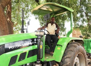 Mr Augustin Bonzi with his newly acquired tractor.