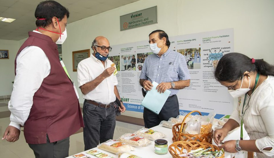 Dr Pingali tastes a product from the nutri-basket developed by the NutriPlus Knowledge Program.