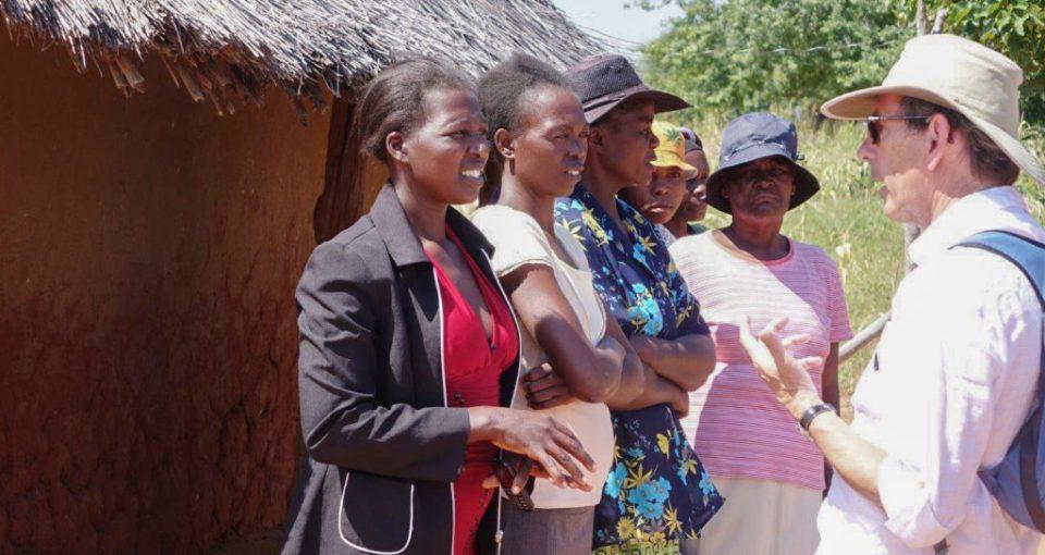 Dr Nigel Kerby interacting with women farmers in a village in Zimbabwe. Photo: J Kane-Potaka, ICRISAT