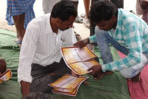 Farmers comparing their Soil Health Card. Photo: ICRISAT