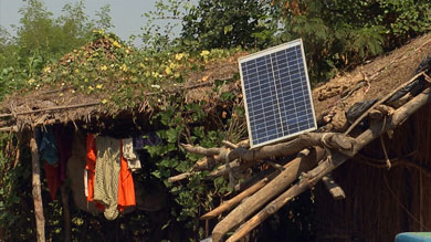 Solar panels sticking out of thatched houses is a common sight in Dunagaria village.