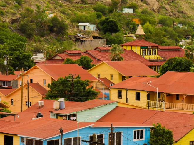 The red roofs and colorful clapboard sandwiched into the narrow arroyo of Santa Rosalía.