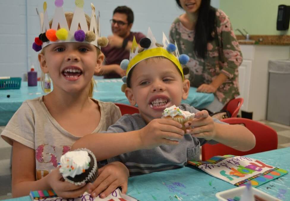 Children eating cupcakes at ArtVille's 14 Birthday Party, May 2018