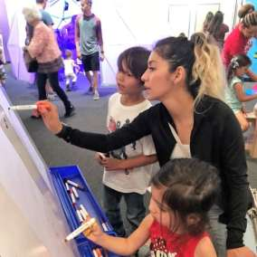 family doodling in the HUB Gallery