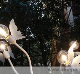 lampada legno e tubi di plastica
