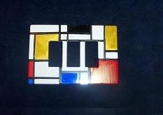 vecchie placchette degli interruttori decorate stile Mondriane