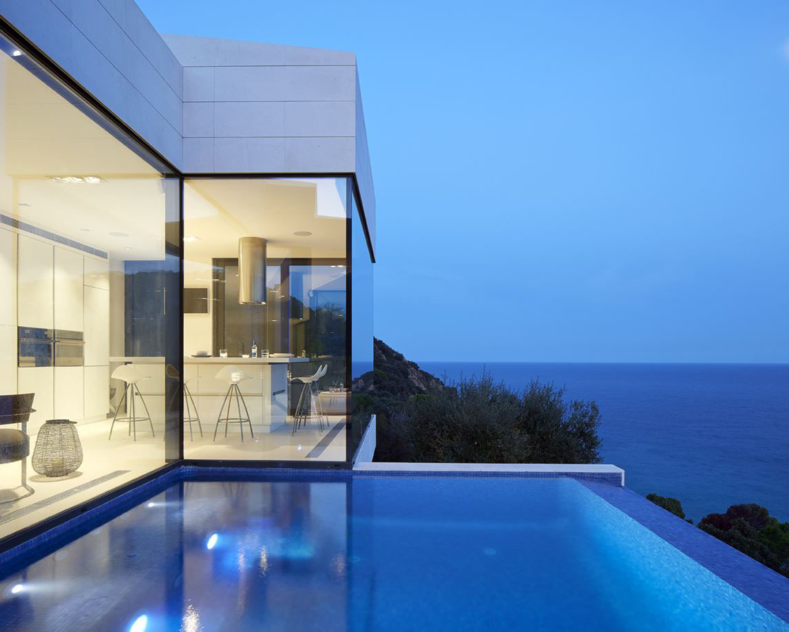 Modern Hillside Coastal Home In Spain With Magnificent