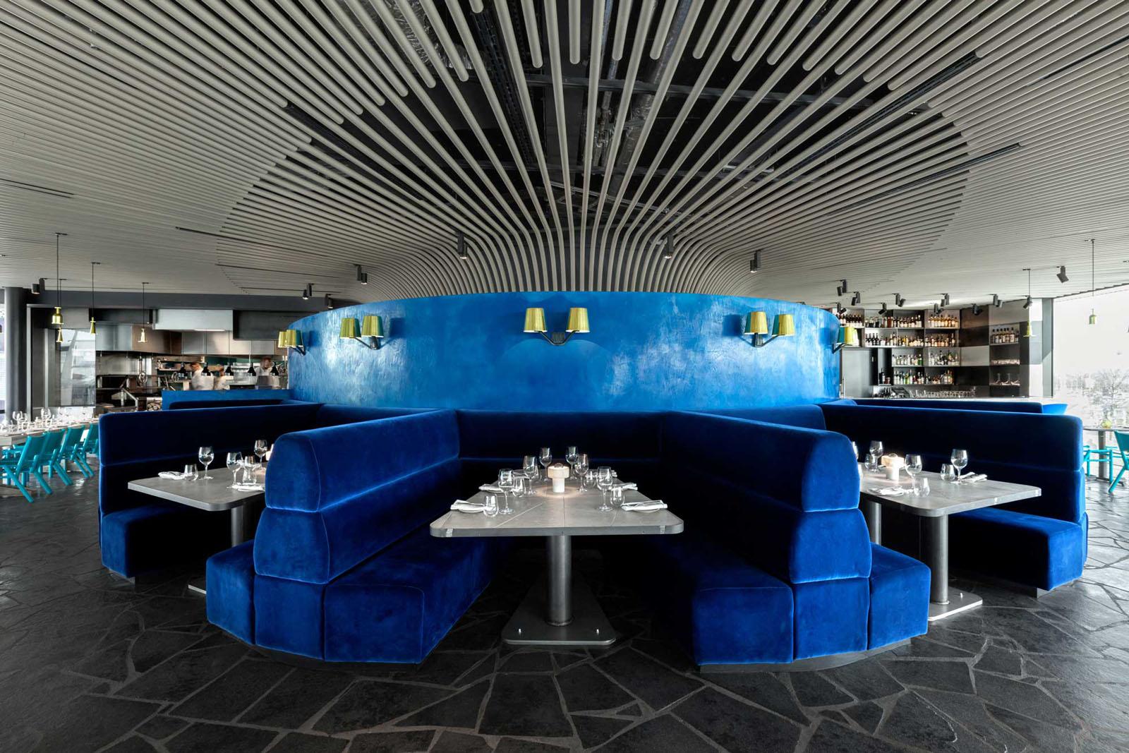 small sized sofas loose grey linen slipcovered sofa craft london restaurant by tom dixon | idesignarch ...