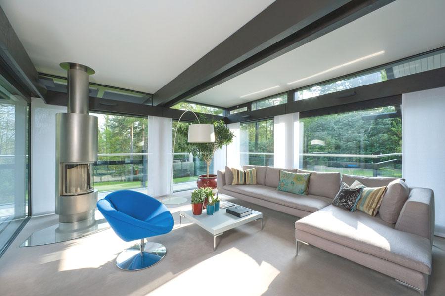 interior design small living room apartment maroon couch huf-haus-darien-house-cobham_4