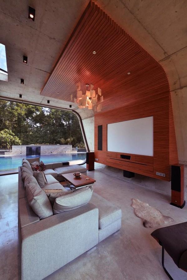 Minimalist Concrete Shell Pool House Overlooks Lush