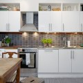 The simple elegance of these white modern kitchens feature white