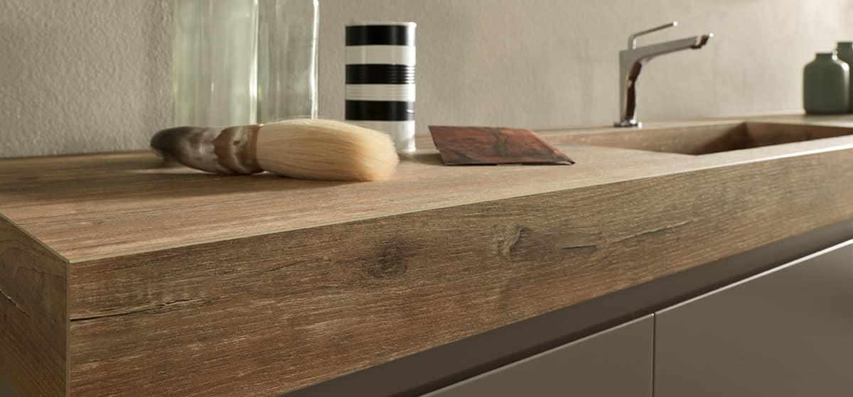 Elegant bathroom cabinet with HPL oak top and washbasin