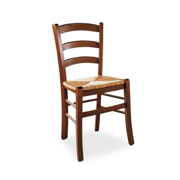 Rustic wooden chair sitting in rice straw for cellar