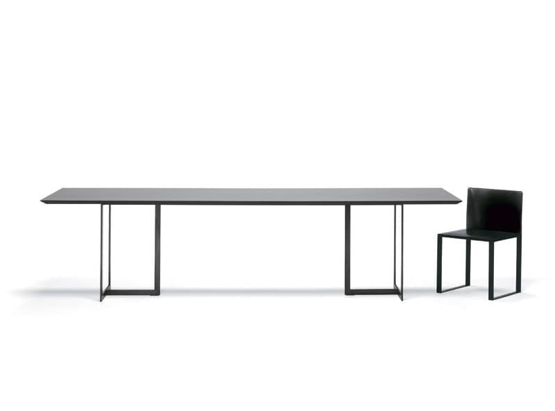 Table with minimal design, metal and glass, for living