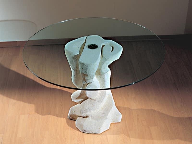 Tavolo rotondo con base in pietra piano in cristallo