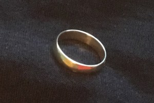gold ring on black background