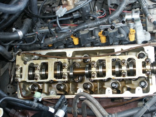 small resolution of make sure not to drop anything in the three oil drain holes located in the cylinder head these lead through the engine block back to the oil pan below