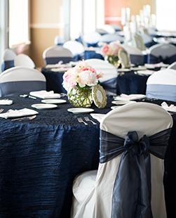 chair cover rentals quad cities target stretchy covers fine linens tablecloths overlays table runners i do events navy wedding decoration sashes bows