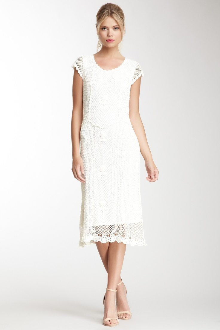 go with a short white cocktail dress for your vow renewal dress
