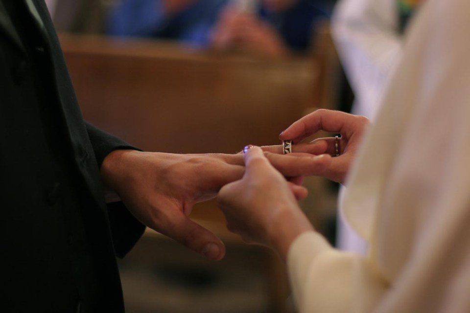 Exchanging Rings At Vow Renewal Ceremony