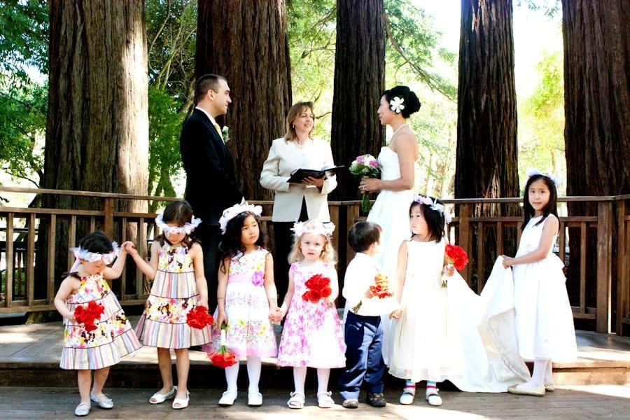 Children in front of couple ready to marry