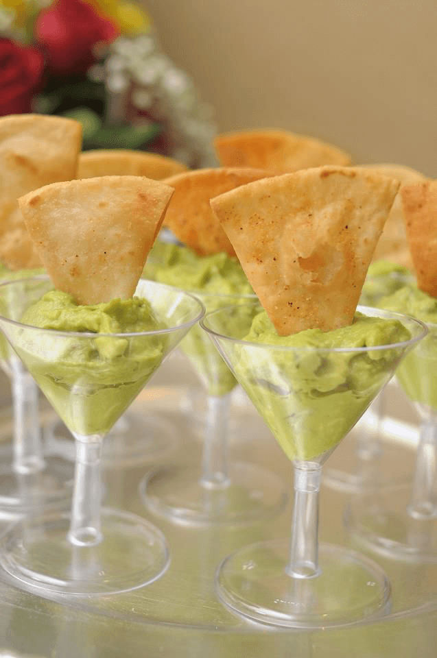 Guacamole in Cocktail Glasses with Crisps Dipped In