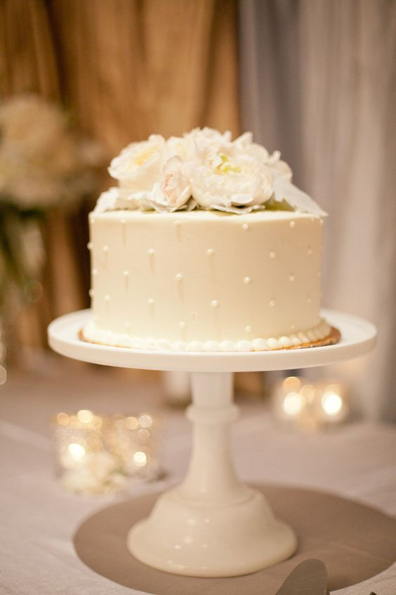Simple single tier white wedding cakes polka dot pearls and florals too can come together and make something sweet junglespirit Gallery