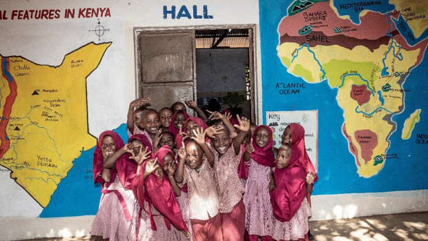 Children in front of an assembly hall at a primary school in Mombasa, Kenya.