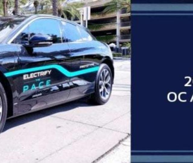 Parked Black  Jaguar I Pace Electric Compact Crossover Suv With A Blue Strip Down